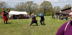 Lord Wilim (L) fighting a lord from Wyldewode with Tiarna Art marshaling.